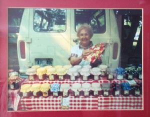 Grammy selling her jams and jellies with her famous white van behind her